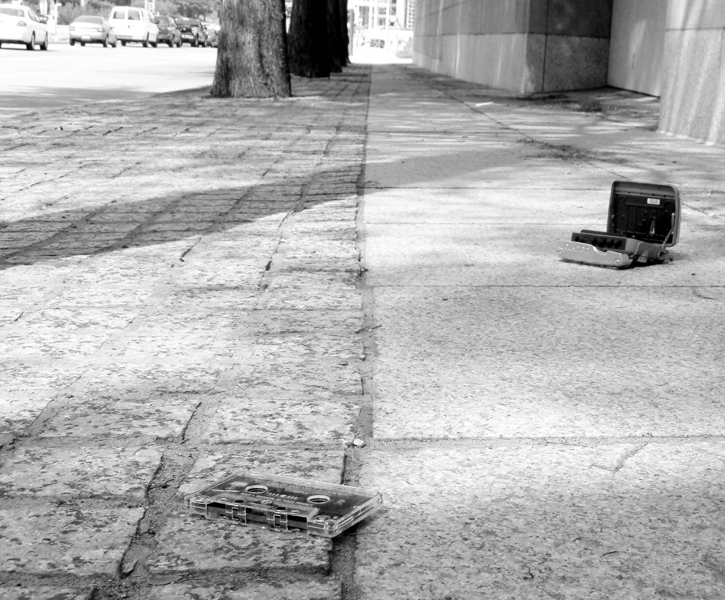 10012 Tape and tape player on sidewalk